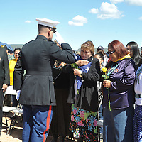 Navajo Nation President Jonathan Nez (left) looks on as A Marine Honor Guard presents burial flag to Vee Brown, daughter of Navajo Code Talker Mr. William Tully Brown during graveside funeral services held at the Ft. Defiance Veteran's Cemetery Thursday.