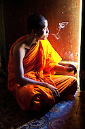 A Buddhist monk sits in the light of a slightly open door while he smokes a cigarette. He is one of the monks at a monastery in Soc Trang Province. Robert Dodge, a Washington DC photographer and writer, has been working on his Vietnam 40 Years Later project since 2005. The project has taken him throughout Vietnam, including Hanoi, Ho Chi Minh City (Saigon), Nha Trang, Mue Nie, Phan Thiet, the Mekong, Sapa, Ninh Binh and the Perfume Pagoda. His images capture scenes and people from women in conical hats planting rice along the Red River in the north to men and women working in the floating markets on the Mekong River and its tributaries. Robert's project also captures the traditions of ancient Asia in the rural markets, Buddhist Monasteries and the celebrations around Tet, the Lunar New Year. Also to be found are images of the emerging modern Vietnam, such as young people eating and drinking and embracing the fashions and music of the West. His book. Vietnam 40 Years Later, was published March 2014 by Damiani Editore of Italy.