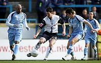 Photo: Paul Thomas.<br />Preston North End v Manchester City. The FA Cup. 18/02/2007.<br /><br />Preston's David Nugent takes on Ousmane Dabo (L) and Joey Barton (R).