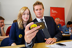 © Licensed to London News Pictures. 07/09/2015. London, UK. Tristram Hunt poses for a picture with a Liz Kendall supporter whilst calling Labour Party members to make sure they vote before the Thursday lunchtime deadline as the Labour leadership election enters the final 72 hours. Photo credit: Tolga Akmen/LNP