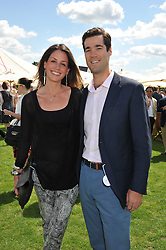 ALICE DANILOVICH and PETER RUSSOTTI at the 27th annual Cartier International Polo Day featuring the 100th Coronation Cup between England and Brazil held at Guards Polo Club, Windsor Great Park, Berkshire on 24th July 2011.