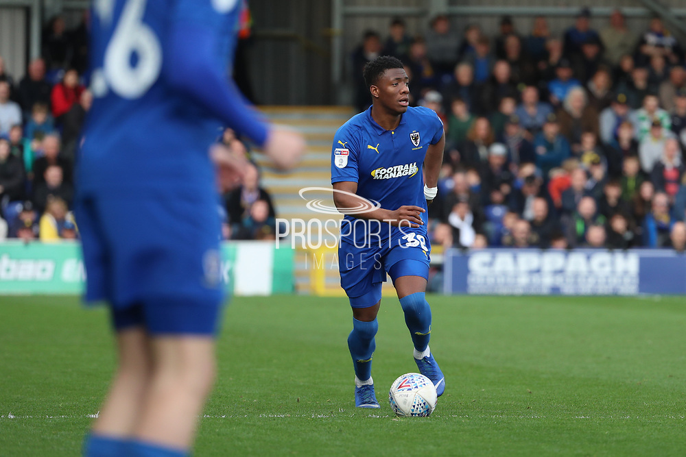 AFC Wimbledon defender Paul Kalambayi (30) dribbling during the EFL Sky Bet League 1 match between AFC Wimbledon and Gillingham at the Cherry Red Records Stadium, Kingston, England on 23 March 2019.