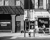 A slice of old Yorkville with FDNY's ladder Co. 13, Erdil's Tailor, a downstairs hair salon and a store for rent; East 87th Street, New York City.