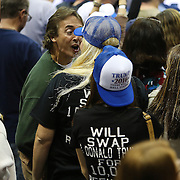 A man in a green shirt argues with two protesters inside a <br /> Republican presidential rally for Donald Trump at the USF Sundome in Tampa, Florida on Friday, February 12 2015.  Photo: Alex Menendez
