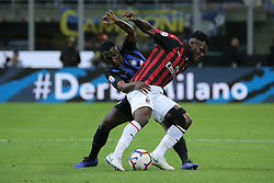 October 21, 2018 - Milan, Milan, Italy - Kwadwo Asamoah #18 of FC Internazionale Milano competes for the ball with Frank Kessie #79 of AC Milan during the serie A match between FC Internazionale and AC Milan at Stadio Giuseppe Meazza on October 21, 2018 in Milan, Italy. (Credit Image: © Giuseppe Cottini/NurPhoto via ZUMA Press)