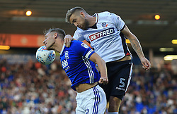 Michael Morrison of Birmingham City goes up with Mark Beevers of Bolton Wanderers for a header - Mandatory by-line: Paul Roberts/JMP - 15/08/2017 - FOOTBALL - St Andrew's Stadium - Birmingham, England - Birmingham City v Bolton Wanderers - Sky Bet Championship