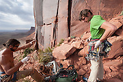 Rock climbers Brad Parker and Rob McKay  (L-R) gearing up for a hard crack route at Indian Creek near Moab, Utah