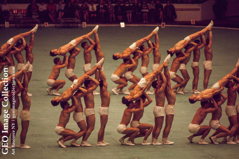 Gymnasts show their skill in Prague's Park of Culture and Recreation.