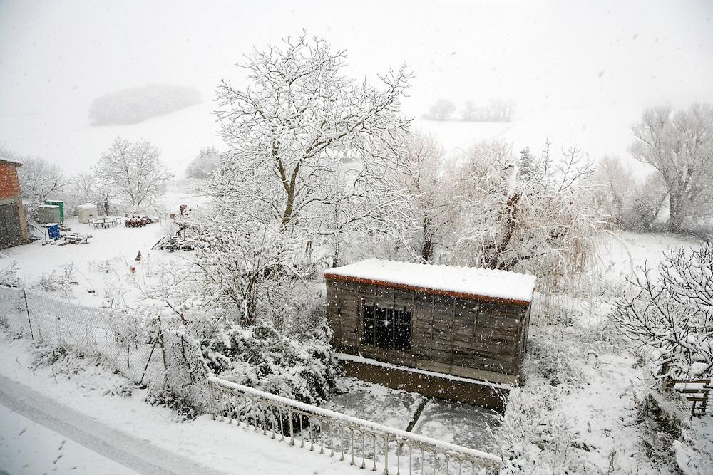 rural landscape during a snow storm