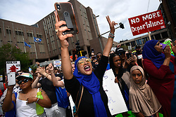 """Asma Jama, of Minneapolis, is energized during a march against the Trump administration's immigration policies on Saturday, June 30, 2018. """"America belongs to all of us,"""" Jama said. """"I'm not gonna sit still."""" Photo by Aaron Lavinsky/Minneapolis Star Tribune/TNS/ABACAPRESS.COM"""