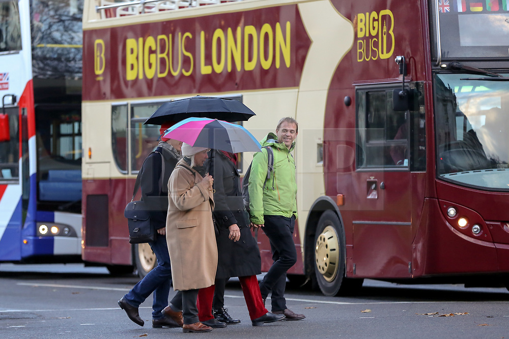 © Licensed to London News Pictures. 8/112/2018. London, UK. Tourists with umbrellas during rain and wet weather in Westminster. Photo credit: Dinendra Haria/LNP