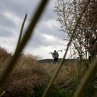 A farmer walks home through the fields ouside of Heshun town, Yunnan province, China.