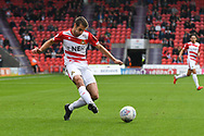 Matty Blair of Doncaster Rovers (17) crosses the ball low during the EFL Sky Bet League 1 match between Doncaster Rovers and Gillingham at the Keepmoat Stadium, Doncaster, England on 20 October 2018.