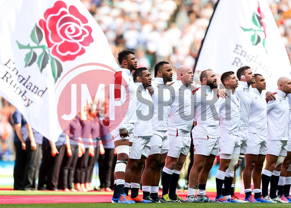 Courtney Lawes, Mako Vunipola and Billy Vunipola of England sing the National Anthem - Rogan/JMP - 24/08/2019 - RUGBY UNION - Twickenham Stadium - London, England - England v Ireland - Quilter Series.