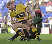 Reading, Berkshire, 29/09/02<br /> London Irish vs Wasps,<br /> Lawrence Dallaglio, tackled by, Exiles Keiron Dawson, during the ZURICH PREMIERSHIP RUGBY match at the Madejski Stadium,  [Mandatory Credit: Peter Spurrier/Intersport Images],
