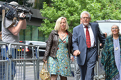 Image ©Licensed to i-Images Picture Agency. 27/06/2014.<br /> <br /> Rolf Harris arrives at Southwark Crown Court, London, UK with the support of his family.<br /> <br /> Pictured (l-r) are Bindi Nicholls, Rolf Harris and Rolf's wife Alwen Hughes.<br /> <br /> <br /> Picture by Ben Stevens / i-Images