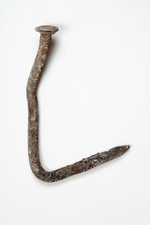 old rusty bent nail