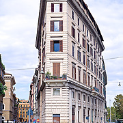 High resolution panorama of wedge shaped building on Via Paolo Mercuri in Rome, Italy