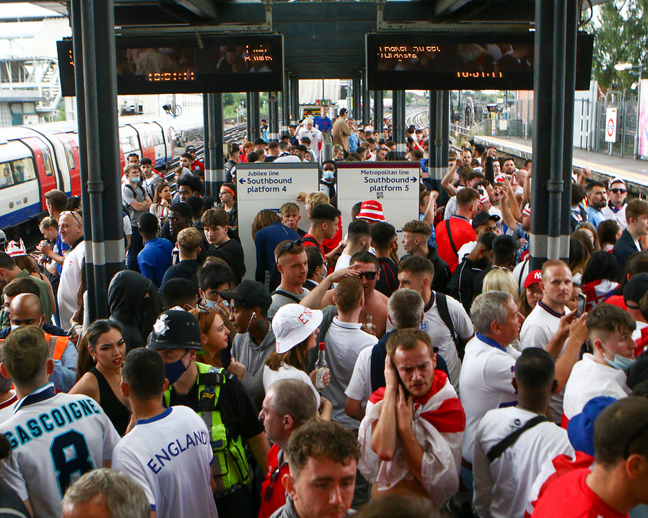 The Wembley Park station is packed with people as they wait for the train to travel towards central London. 11/07/2021, Marcin Riehs/Pathos