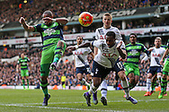 Danny Rose of Tottenham Hotspur heads the ball over Ashley Williams, the Swansea City captain.Barclays Premier league match, Tottenham Hotspur v Swansea city at White Hart Lane in London on Sunday 28th February 2016.<br /> pic by John Patrick Fletcher, Andrew Orchard sports photography.