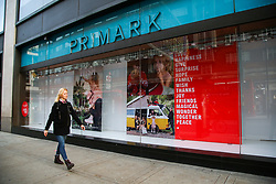 © Licensed to London News Pictures. 07/11/2020. London, UK. A woman walks past Primark store on Oxford Street on the first weekend of the as non-essential businesses, pubs and restaurants remain closed until Wednesday 2 December due to second national COVID-19 lockdown to control the spread of coronavirus. Photo credit: Dinendra Haria/LNP
