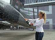 Image licensed to Lloyd Images. Free for editorial use. <br /> Pictures of Georgie  Ainslie wife of Sir Ben Ainslie (GBR) skipper of the Land BAR British Americas Cup team, naming  his new AC45F catamaran named Rita in the Portsmouth Historic Dockyard.<br /> Credit: Lloyd Images