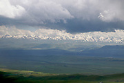 Kyrgyzstan, Suusamyr Valley lies at 2,000-2,500 meters above the sea level between Suusamyr Too and Kyrgyz Ala-Too ranges of Tian Shan mountains in Central Asia. Suusamyr River flows through it.