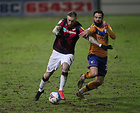 Bolton Wanderers Marcus Maddison in action with Mansfield Town's Stephen McLaughlin<br /> <br /> Photographer Mick Walker/CameraSport<br /> <br /> The EFL League 2 - Mansfield Town v Bolton Wanderers  - Wednesday 17th February  2021 - One Call Stadium-Mansfield<br /> <br /> World Copyright © 2020 CameraSport. All rights reserved. 43 Linden Ave. Countesthorpe. Leicester. England. LE8 5PG - Tel: +44 (0) 116 277 4147 - admin@camerasport.com - www.camerasport.com