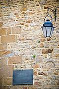 UNESCO World Heritage plaque and street lamp, Mont Saint-Michel, Normandy, France