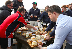 Embargoed to 0001 Monday August 28 Refreshments are handed out during a match between the Ship Inn Cricket Club and the Eccentric Flamingoes Cricket Club on Sunday April 30th, 2017, in front of the pub in Elie, Fife, which is the only one in Britain to have a cricket team with a pitch on the beach. The Ship Inn Cricket Club season runs from May to September with dates of matches dependent on the tides. Any Batsman who hits a six which lands in the Ship Inn beer garden wins their height in beer and any spectator who catches a six in the beer garden also wins their height in beer.