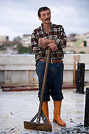 a worker on one of the many anchovy boats in the port of Sinop.