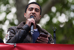 London, UK. 1st May, 2019. Cameron Joshi of Global Justice Now addresses climate protesters at a Declare A Climate Emergency Now demonstration in Parliament Square organised to coincide with a motion in the House of Commons to declare an environment and climate emergency tabled by Leader of the Opposition Jeremy Corbyn. The motion, which does not legally compel the Government to act, was passed without a vote.