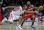 March 25, 2009; Houston, TX, USA;  Houston Rockets forward Trevor Ariza (1) tries to steal the ball from Los Angeles Clippers guard Baron Davis (1) in the first half at the Toyota Center.  The Clippers won 99-93. Mandatory Credit: Thomas Campbell-US PRESSWIRE