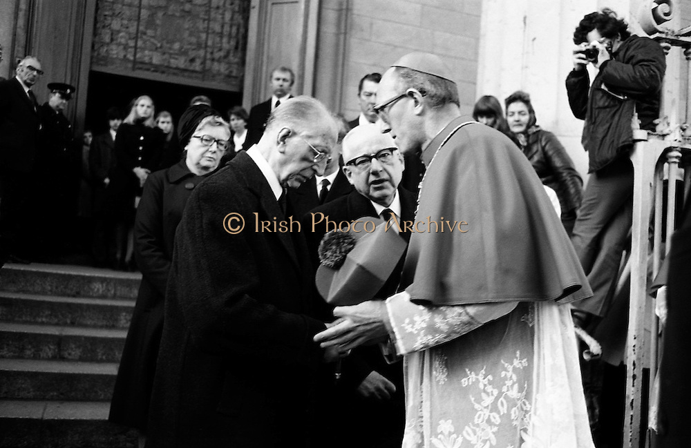 Eamon de Valera is consoled by the Archbishop of Dublin, Dermot Ryan, after the funeral Mass for his wife, Sinead de Valera, in the Pro-Cathedral. Born in 1878, Sinead Bean de Valera wrote many books for children, in English and in Irish, including books of Irish fairy tales.<br /> 09/01/1975