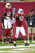 Arizona Cardinals rookie wide receiver Chad Williams (16) jumps in the air and celebrates with Arizona Cardinals linebacker Zaviar Gooden (52) after Williams returns an apparent fumble recovery for a touchdown on a punt ruled an illegal touch during the 2017 NFL Pro Football Hall of Fame preseason football game against the Dallas Cowboys on Thursday, Aug. 3, 2017 in Canton, Ohio. The Cowboys won the game 20-18. (©Paul Anthony Spinelli)