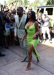 Kim Kardashian wears a neon yellow latex dress as she and husband Kanye West arrive to the wedding of 2 Chainz at the Versace Mansion in Miami Beach, Florida. 18 Aug 2018 Pictured: Kim Kardashian West; Kanye West; Kanye West. Photo credit: MEGA TheMegaAgency.com +1 888 505 6342