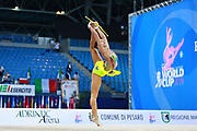 Kaho Minagawa of Japan competes during the Rhythmic Gymnastics Individual qualification clubs  of the World Cup at Adriatic Arena on April 2, 2016 in Pesaro, Italy. She was born 20 August 1997 in Chiba Prefecture, Japan
