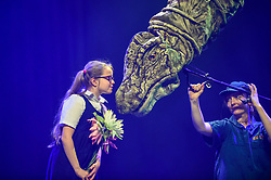 © Licensed to London News Pictures. 13/02/2020. LONDON, UK. A pupil from Stockwell Primary School meets a Titanasaur  from Erth's Dinosaur Zoo, one of the acts forming part of Imagine Children's Festival at Southbank Centre for half term 12 to 23 February 2020. (Permission to photograph obtained from schools teacher).  Photo credit: Stephen Chung/LNP