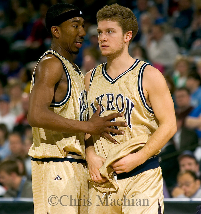 3/16/06 -- Omaha, ne   Akron's Dru Joyce (with headband) talks with Chad Mraz in the first round game of the NIT at Qwest Center Omaha.. (Photo by Chris Machian/Prairie Pixel Group).
