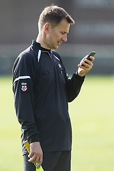 © Licensed to London News Pictures . 28/09/2014 . Birmingham , UK . Health Secretary JEREMY HUNT serves as linesman during the match , talks on his mobile phone during half time . Conservative Party vs Journalists football match at a Birmingham University football pitch , at the start of the conference . The 2014 Conservative Party Conference in Birmingham . Photo credit : Joel Goodman/LNP