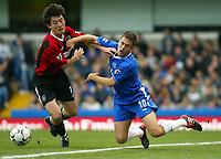 Photograph: Scott Heavey,  Digitalsport , Chelsea v Manchester City. FA BArclaycard Premiership. 25/10/2003.<br />Sun Jihai shoves Joe Cole off the ball and off the pitch