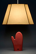lamp shade with a red oven glove