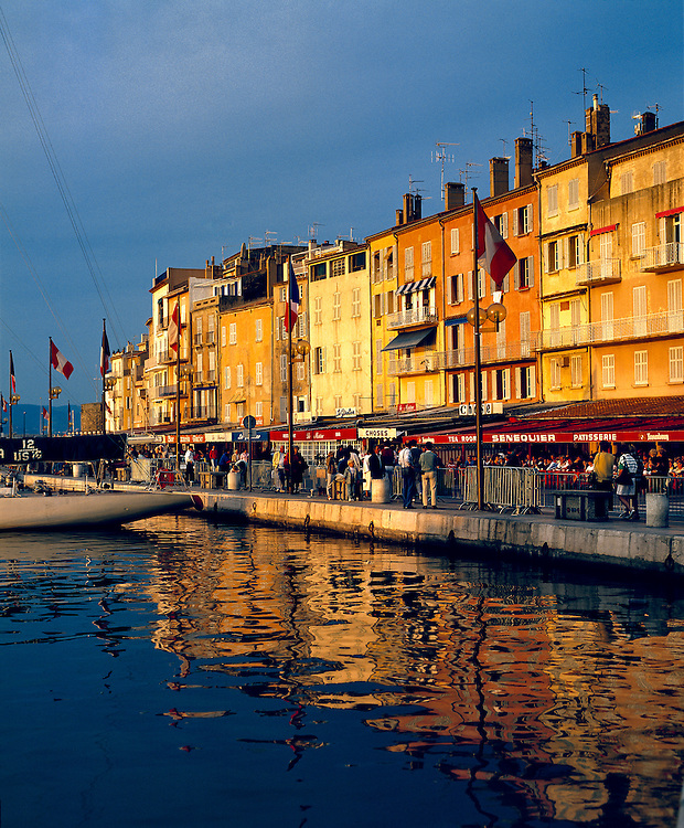 The cafes along the harbor are filled with people-watchers in St. Tropez on the Riviera in France.