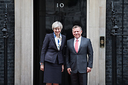 © Licensed to London News Pictures. 01/03/2017. London, UK. British Prime Minister Theresa May receives King Abdullah II of Jordan outside No 10 Downing Street. Photo credit: Rob Pinney/LNP