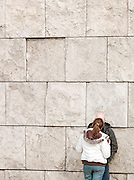 Couple kissing in the street, Rome, Italy