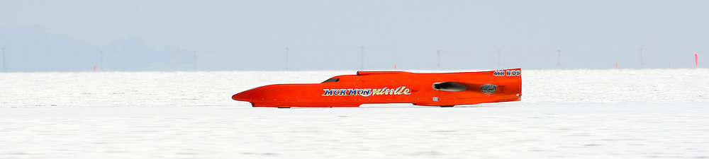 The best cars-people-atmosphere-photos of 2009 Bonneville Speed Week-  The Mormon Missile Streamliner, owned by Lynn Goodfellow of Boulder City, Nevada, rolls down the long track at the Bonneville Speed Way. August 9, 2009.  Photos by Colin E. Braley