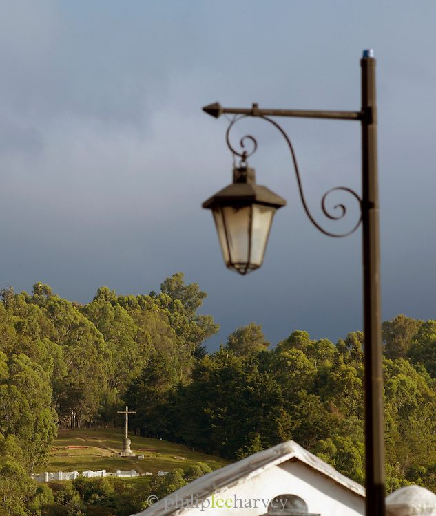 A street light and Christian monument in Antigua, a UNESCO World Heritage Site in Guatemala