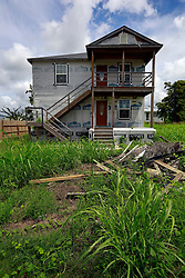 23 August 2013. Lower 9th Ward, New Orleans, Louisiana.<br /> Katrina 8 years later. In a tale of two cities, the hardest hit neighbourhoods struggle to revitalize and return. Many half finished or blighted properties and vacant overgrown lots remain dotted throughout the landscape with limited new construction projects. Residents who have returned complain of limited services, infrequent police patrols, high crime rates, rampant mosquitos and uncontrolled vermin. <br /> Photo; Charlie Varley