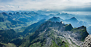 The limestone Churfirsten group (on left) forms a distinctive line of peaks the Appenzell Alps, in the Canton of St. Gallen, Switzerland, as seen to the south from atop Säntis. Shared by three cantons, Säntis can be reached easily via cable car or with effort via trails, to see vast mountain views (here looking southwest at center). The Appenzell Alps rise between Lake Walen and Lake Constance. This image was stitched from multiple overlapping photos.