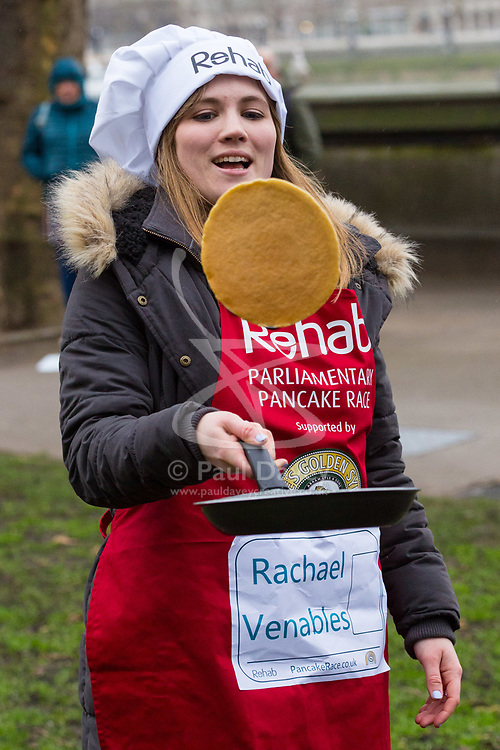 MPs and members of the House of Lords compete in the annual Rehab pancake race, a relay of eleven laps in Victoria Tower Gardens adjacent to the Houses of Parliament in London. The race is held every year on Shrove Tuesday and was won by the Media team. PICTURED: Rachael Venables, LBC Radio. London, February 13 2018.
